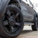 A black Ford Ranger with KMC Rockstar XD 2 wheels in matte black. Wrapped with nitto terra grappler tyres. A close up fitment shot of the Ford Ranger.