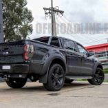 A black Ford Ranger with KMC Rockstar XD 2 wheels in matte black. Wrapped with nitto terra grappler tyres. A rear shot of the Ford Ranger.